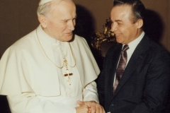 His Holiness Pope John Paul II greets CESJ President Norman Kurland, commending the work of the Center for Economic and Social Justice, 1987.
