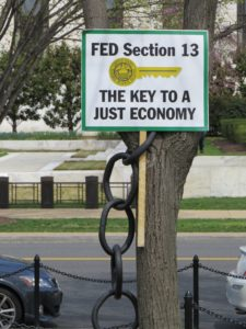 Protest sign - Fed Section 13: The Key to a Just Economy