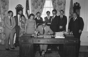 Photograph of Del. Governor Pierre S. (Pete) signing into law a bill making broadened capital ownership and employee stock ownership plans (ESOPs) official policy to be encouraged by all agencies of the State of Delaware. Legislative Hall, Dover, Delaware, June 22, 1981.